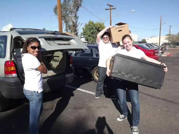 Steven, Katelyn and Shayla transporting food