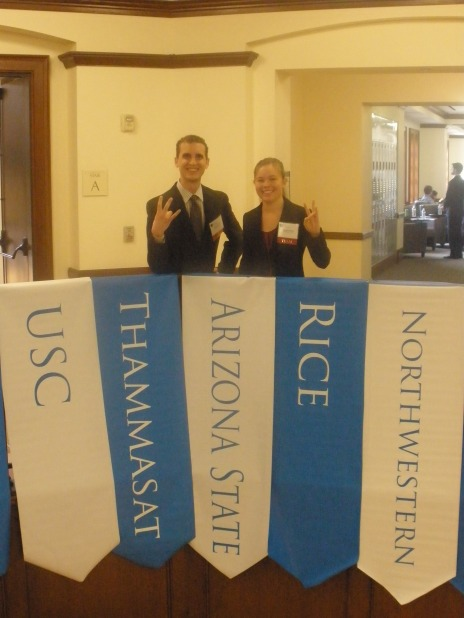 """Eric and Katelyn saying """"Go Devils!"""" in the Jones Graduate School of Business at Rice University."""